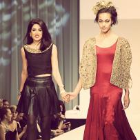 Designer Azeeza Khan from AZZA at the Fashion Takes Flight runway show which is the finale of Mario, Make Me a Model competition and the headlining show at the Fashion Focus Chicago 2012. Model from Factor.