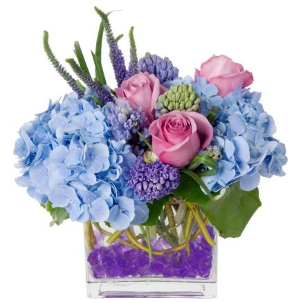 Purple and Blue Hydrangea Roses and Hyacinth In Glass Cube