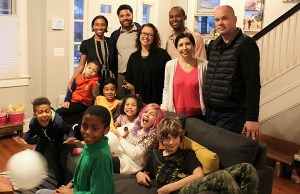 Ronnie and Ellie Ford (second and third from left, couch) and Vanessa and J.R. Ford (center, standing) with the two other families -- Photo: Fallon Forbush