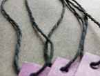 Purple tags string with our heavyweight black cotton string.
