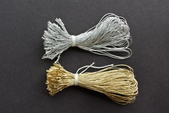 Bundles of gold and silver metallic lamé with trimmed tails.