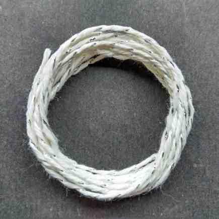 Coil of silver-white metallic yarn.