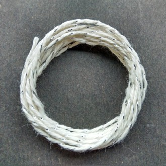Coil of silver-white metallic yarn