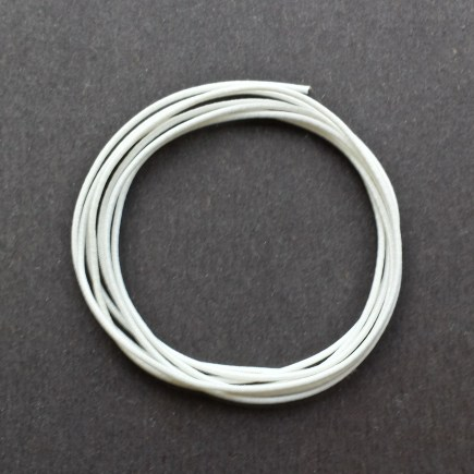 A coil of our white non-fray elastic.