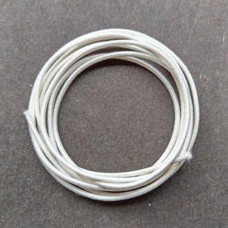 A coil of our #80 elastic in white.