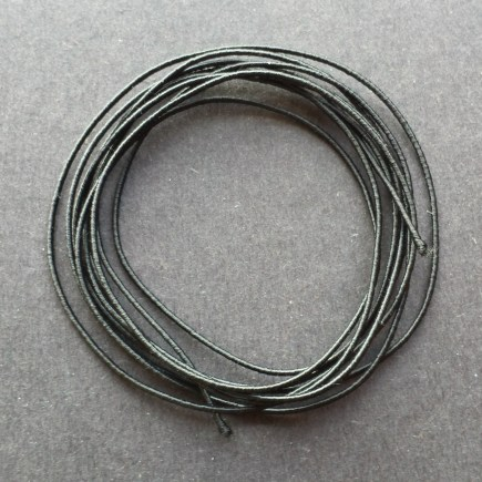 A coil of our standard elastic in black.