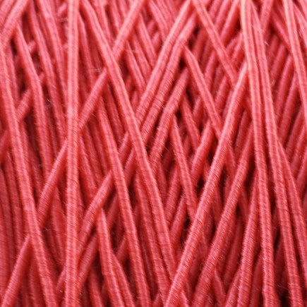 A spool of our standard elastic in red.