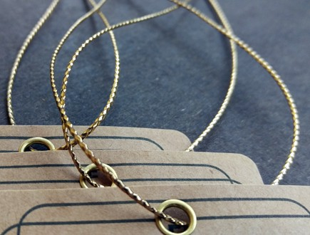 Brown Kraft paper tags with simple border pattern and brass eyelet strung with our gold braid.