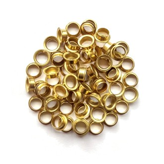 A pile of M&F Stringing's brass eyelets.
