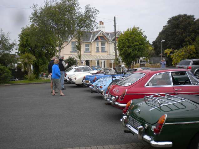The cars of Hogg, Edwards, Scott, Hubbard, Vickers, Gough and Calvert in the hotel car park; rear view