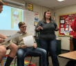 Mrs. Liz Henkel works with Spanish 1 students during class on Friday.