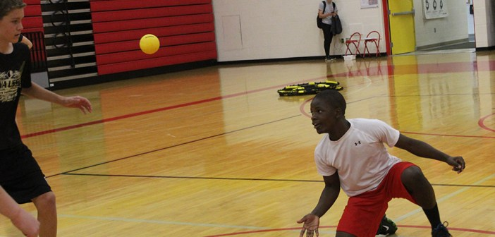 Niyo Gady, '20, gets some exercise by playing Spike Ball in his gym class.
