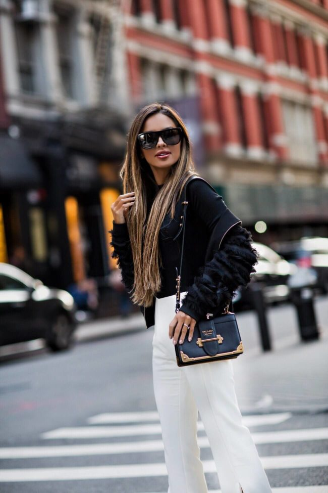 fashion blogger mia mia mine wearing a prada cahier bag at nyfw 2017