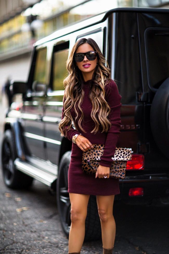 fashion blogger mia mia mine wearing a burgundy casual dress from intermix