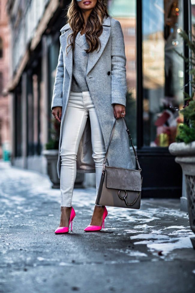 mia mia mine wearing hot pink heels and a club monaco gray coat