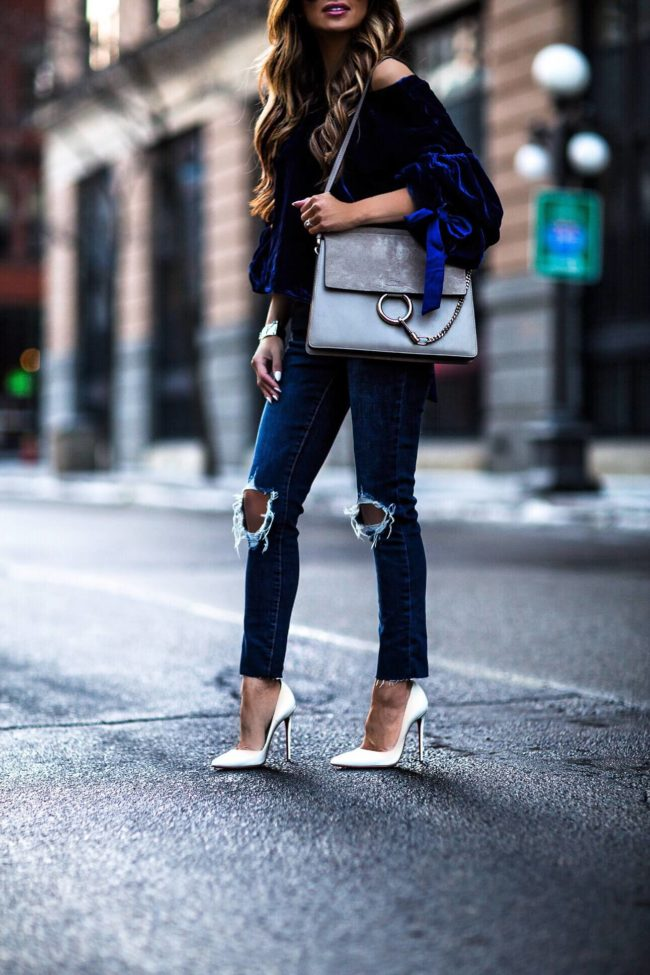 fashion blogger mia mia mine wearing a chloe faye bag and white louboutin heels