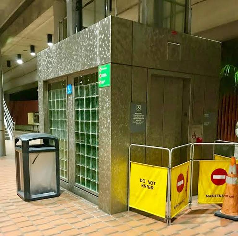 An out-of-order elevator at a Metrorail station makes the commute more difficult for some passengers.