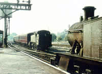 Vol 12: Prarie tanks 4157 & 4107 pass at Ross on Wye, 2nd September 1964