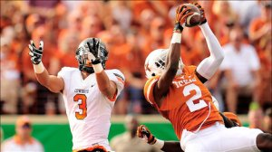 Rare Texas highlight: Mykkele Thompson intercepts OK St. in the first quarter, when Texas trailed 7-3.