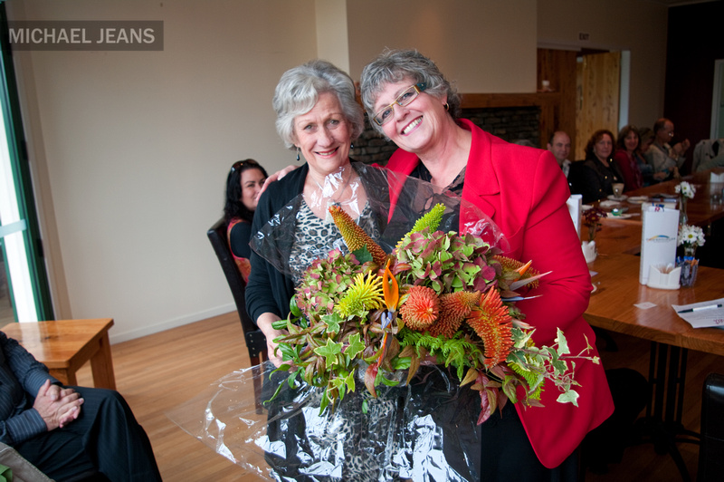 Denise Hattie (left) presents Karen Emanuel with flowers at the 6th birthday celebration of In 2 Connect Cambridge at Powerhouse Karapiro Tuesday the 25th of May 2011.