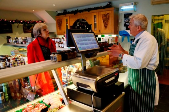 Britain's Prime Minister Theresa May speaks with Jerry Rook visits a local butchers shop in her constituency of Maidenhead ahead of Small Business Saturday, in Maidenhead, Britain December 2, 2016. REUTERS/Stefan Wermuth - RTSUC7X