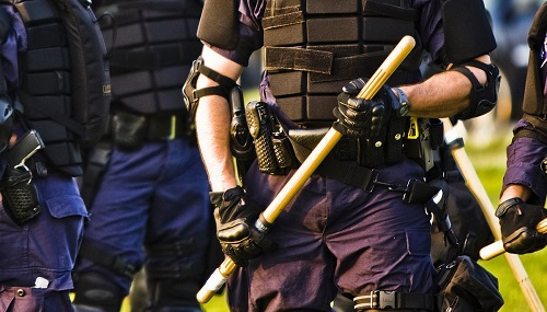 Police_officer_with_baton_(2822106994) small