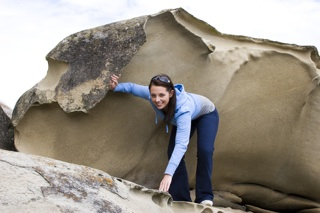 Young Woman Climbing Sandstone