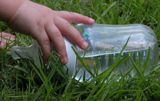 Baby Bottle in Grass