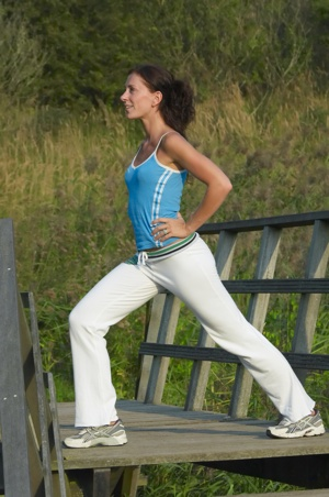 Woman Exercising Beginning Lunges