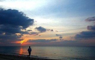 Dad Jogging On the Beach at Sunrise