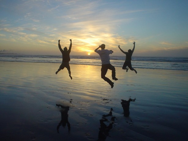 People jumping for joy at the beach