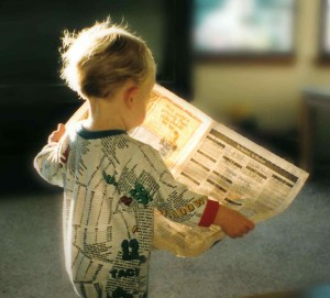 Preschooler with Newspaper