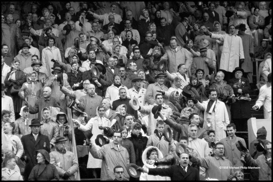 crowd cheering at football game