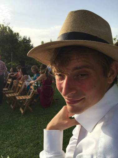 At a wedding, in a hat