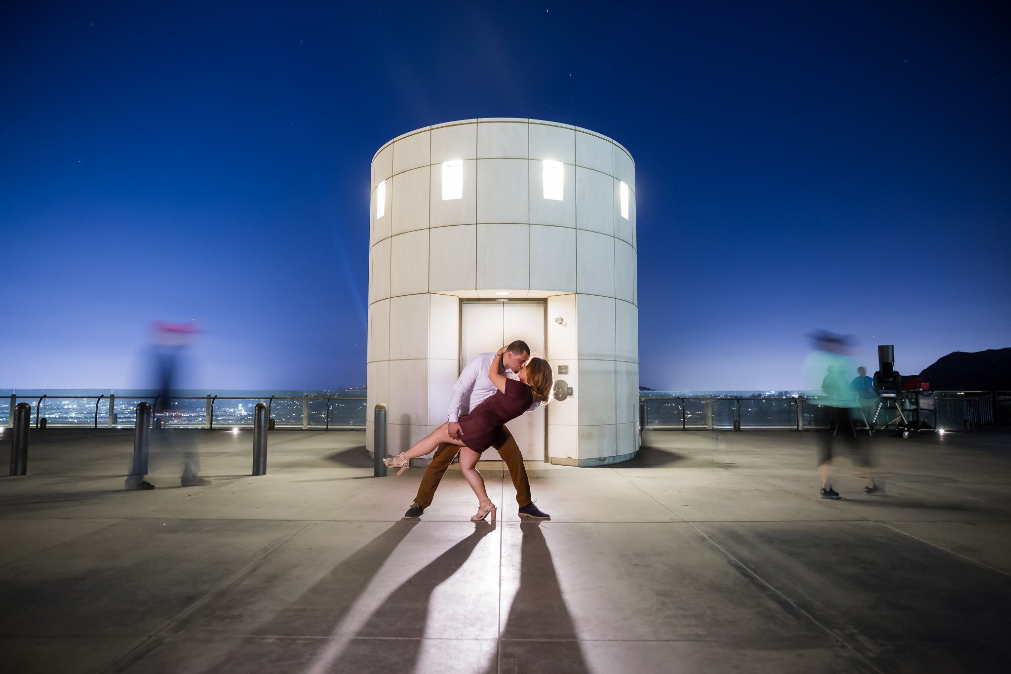 couple kissing at the griffith observatory
