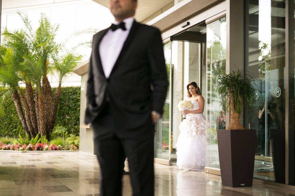 bride walking toward groom for first look