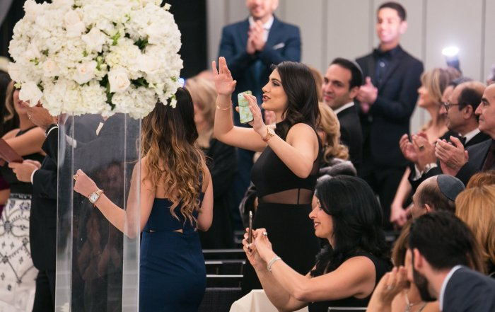 woman with cell phone during unplugged wedding