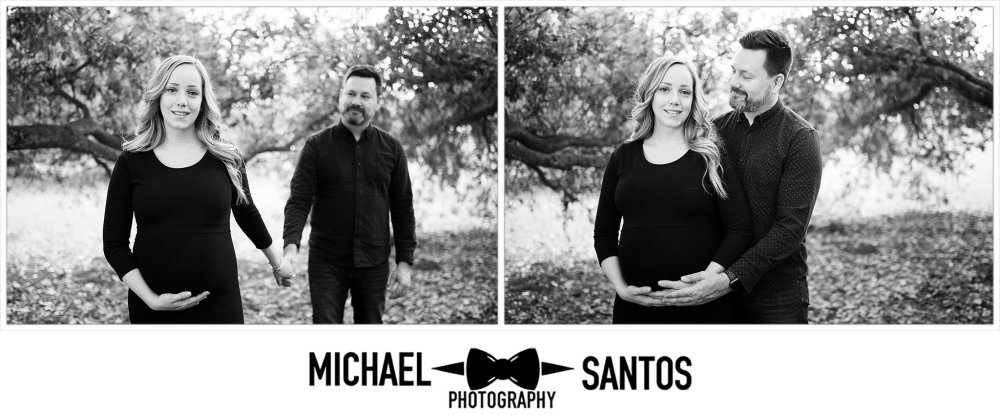 black and white photos of husband hugging pregnant wife from behind at irvine regional park
