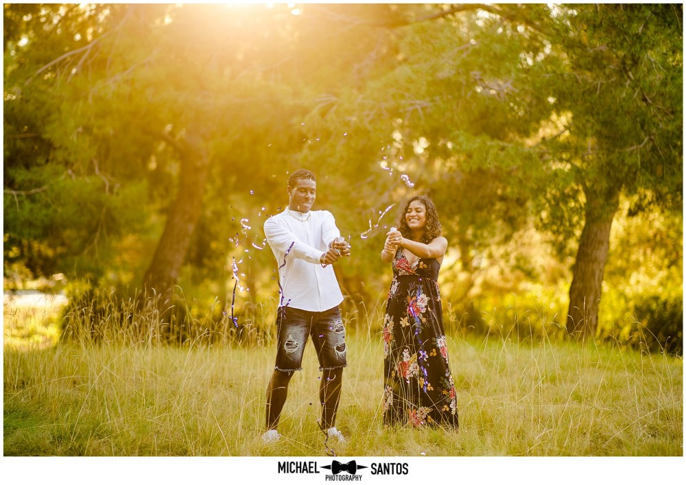 expecting couple reveal the gender of their baby during their baby announcement photography session