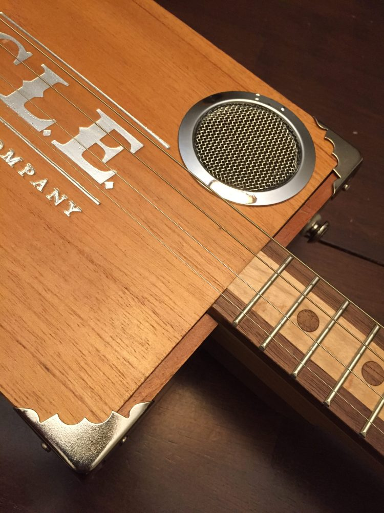 CLE Cigar Box Guitar Build - Sound-hole closeup and fretboard.