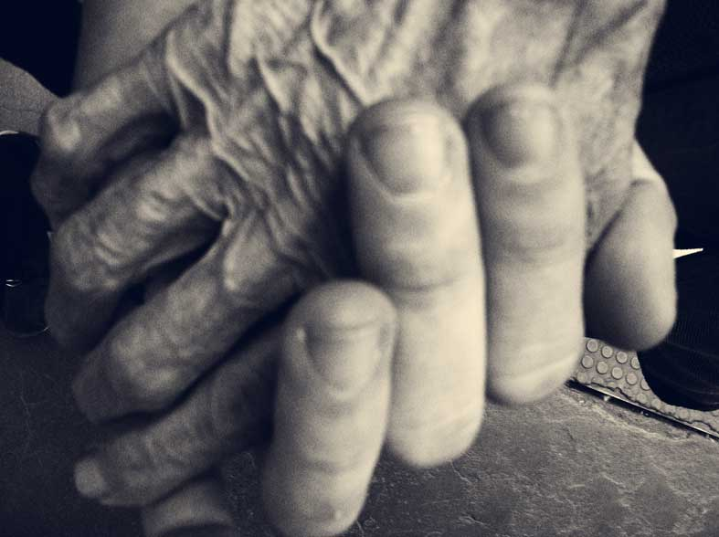 From-old-to-young-joshua's-hand-with-elderly-lady