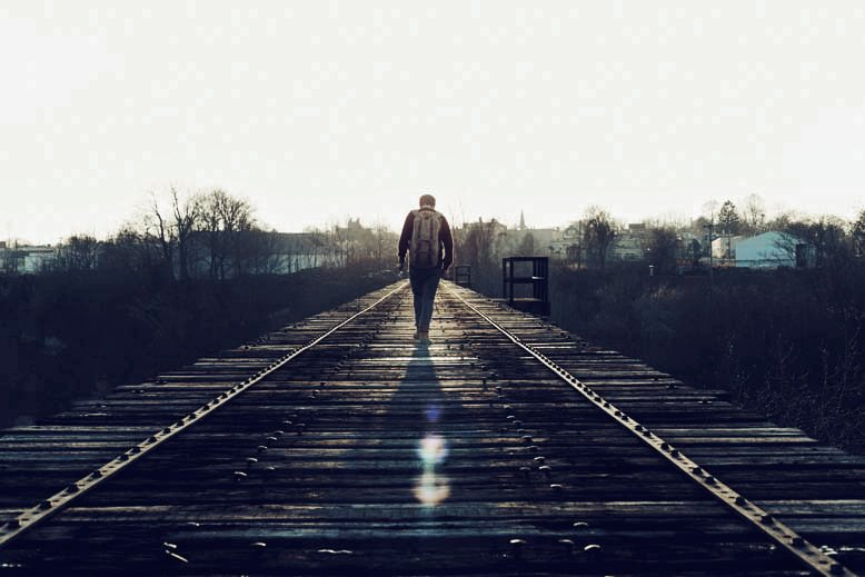 man-walking-train-tracks-michael-woroniecki-blog