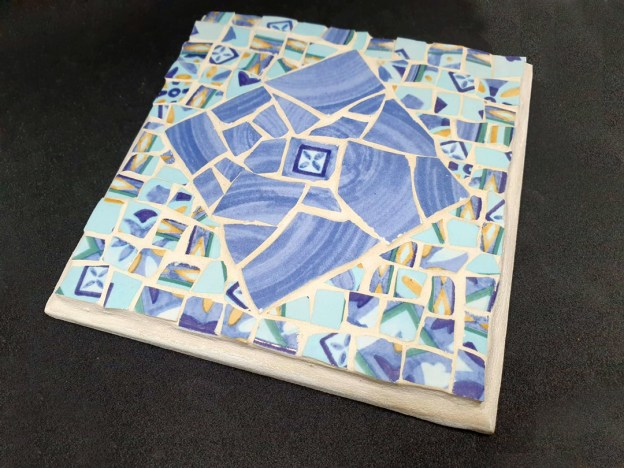 blue hot holder mosaic work by michal ozeri
