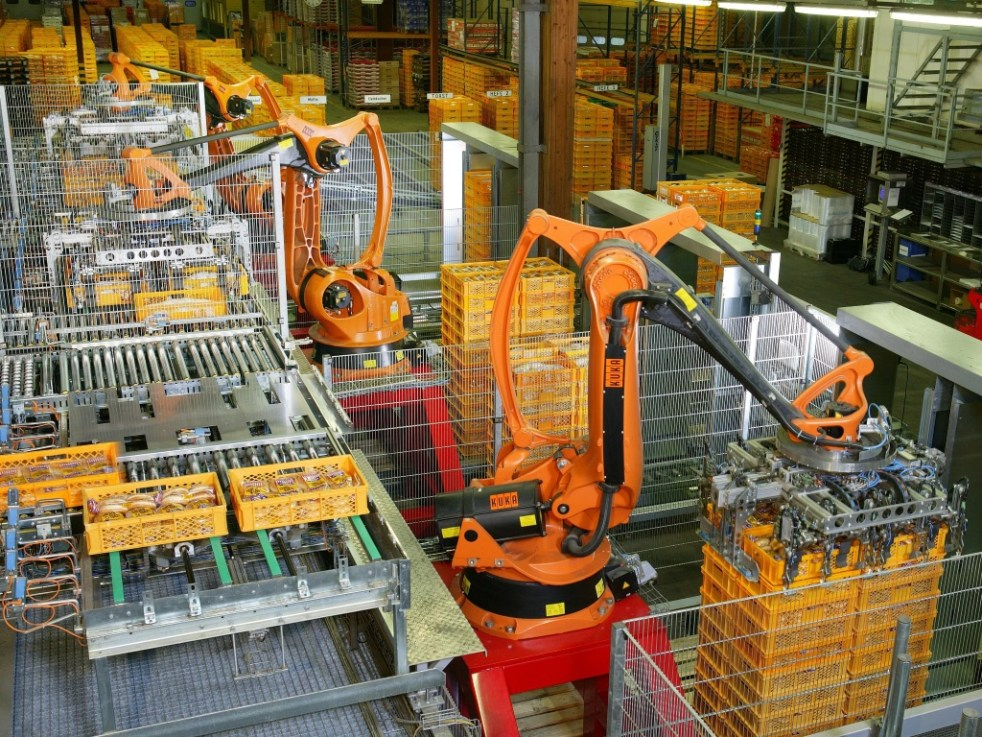 Factory automation robotics putting bread crates on pallets