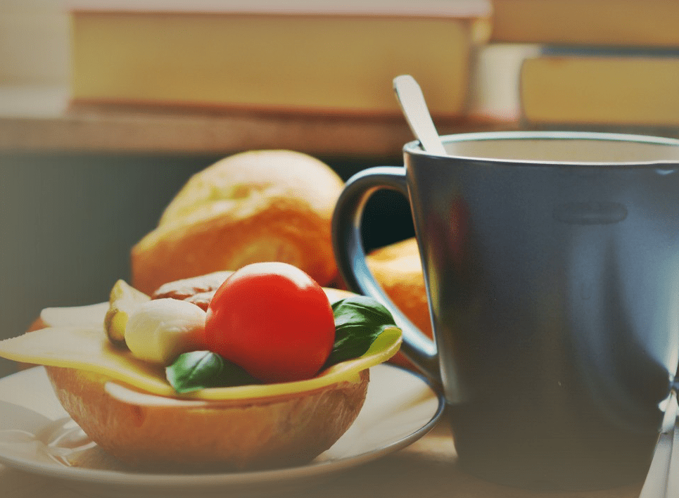 Fruit cup, bread, and books