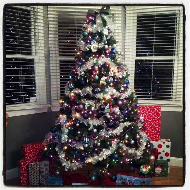 Tree is trimmed ! #photography #Christmas #tree #holiday #decorations #balls