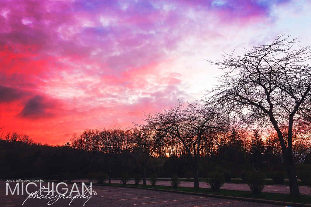 The parking lot at the Pinckney State Recreation Area at sunset.