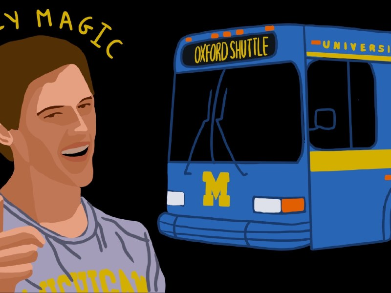 Billy Magic winking in front of a Michigan bus