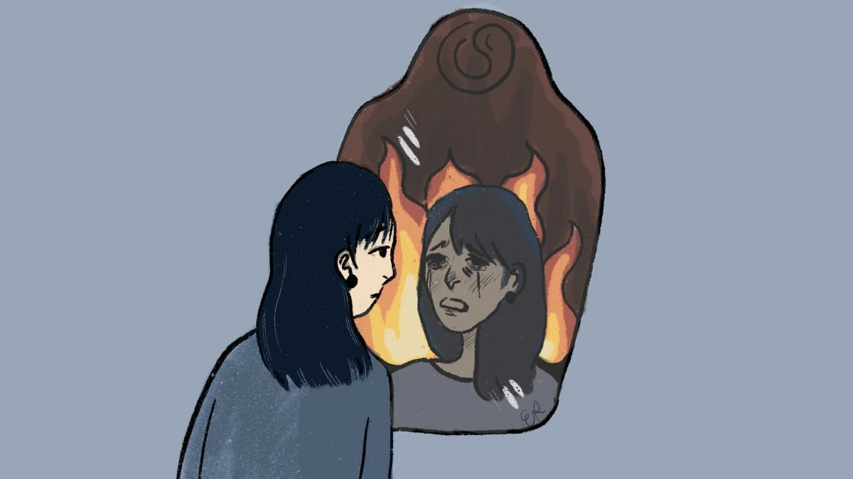 girl looking into mirror in which she is on fire