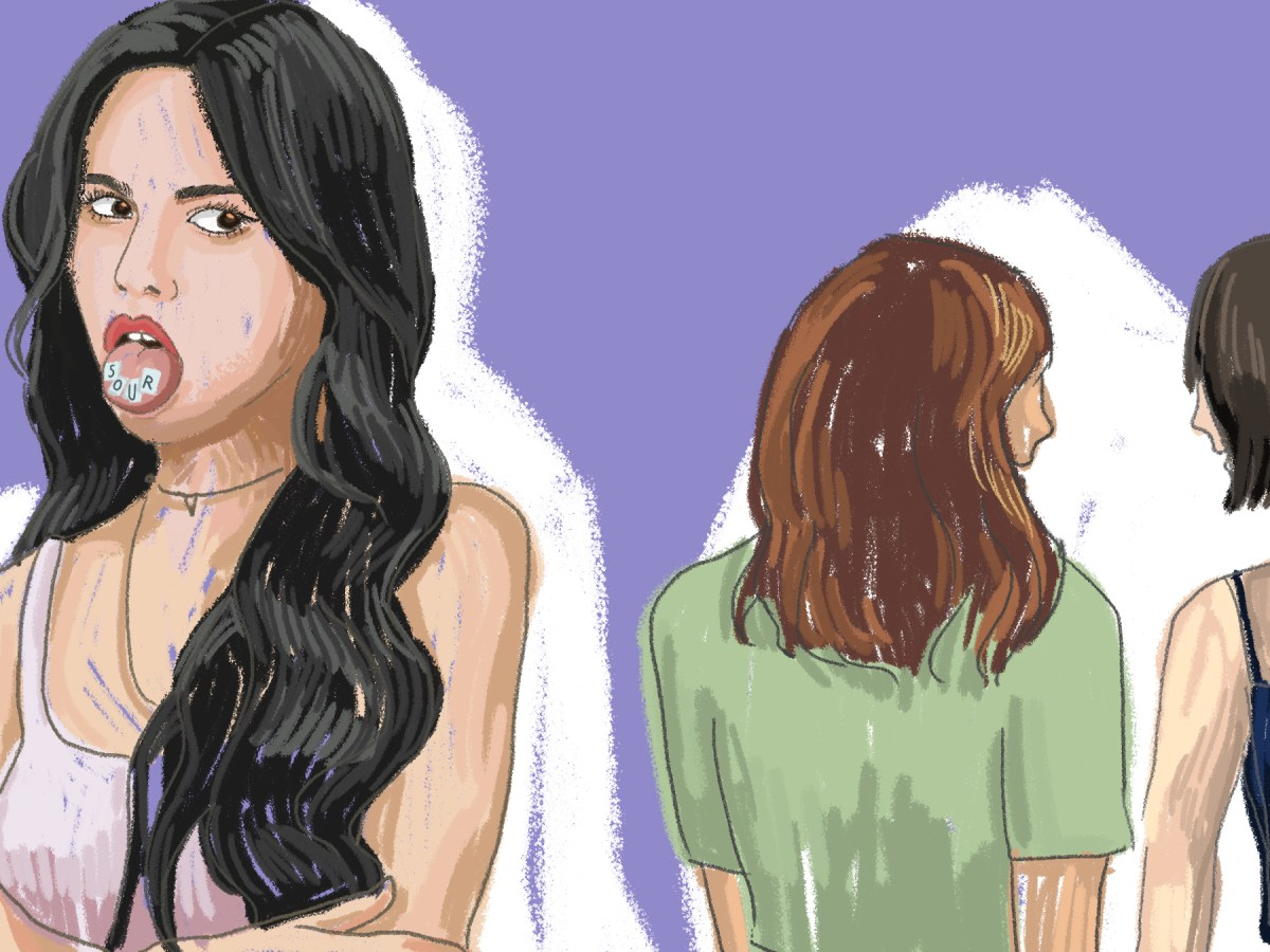Girl looking back with disgust at two other girls